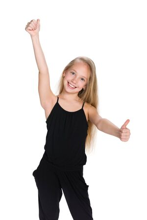 A preteen girl holds her thumbs up against the white background
