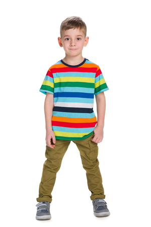 alone boy: A fashion little boy stands against the white background