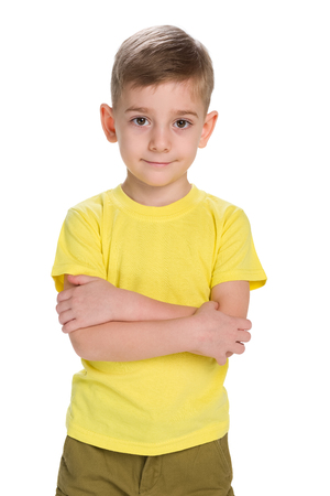 boy kid: A clever little boy stands against the white background