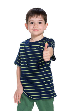 handsome boys: A handsome little boy holds his thumb up Stock Photo