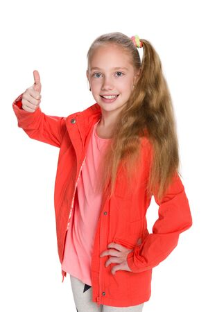 fashion girl: A fashion little girl  in the red jacket holds her thumb up