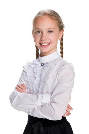mignonne petite fille: Un portrait d'une jolie écolière sur le fond blanc