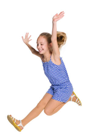 cute blonde: A happy girl jumps on the white background Stock Photo