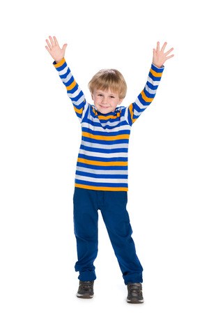 A cute little boy holds his hands up