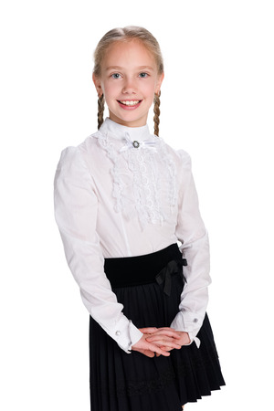 A portrait of a pretty schoolgirl on the white background