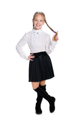 colegiala: Una colegiala sonriendo con coletas se destaca contra el fondo blanco