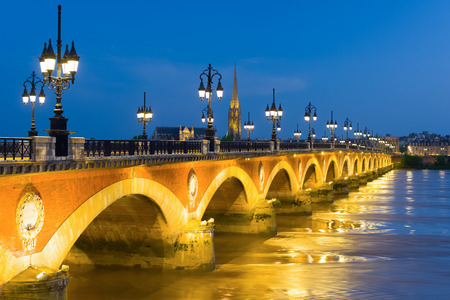 city building: View of old bridge in Bordeaux at a summer night Stock Photo
