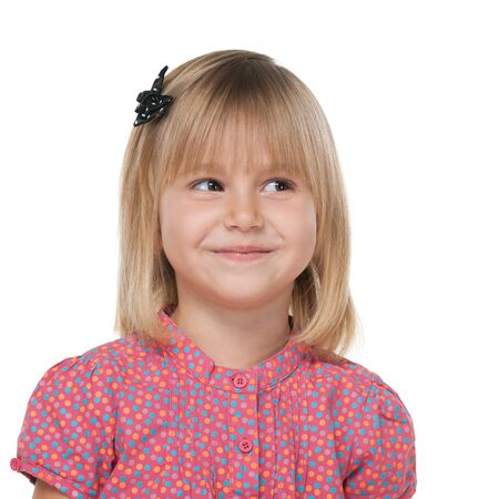 imagines: A pretty little girl imagines against the white background