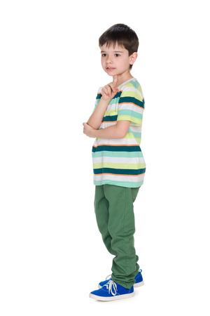 alone boy: A profile portrait of a little boy on the white background