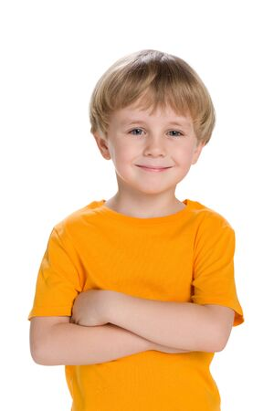 child smile: A portrait of a confident little boy in a yellow shirt Stock Photo