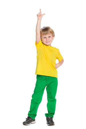 arms up: A smiling little boy shows his finger up