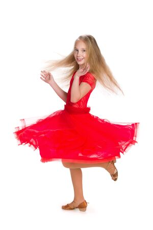 girl in red dress: A happy girl in a red dress on the white background