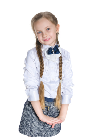 young schoolgirl: A portrait of a smiling schoolgirl against the white background