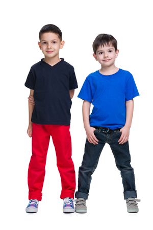 young boys: Two happy young boys stand together on the white background