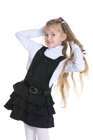 petite fille avec robe: Une petite fille mignonne sur le fond blanc