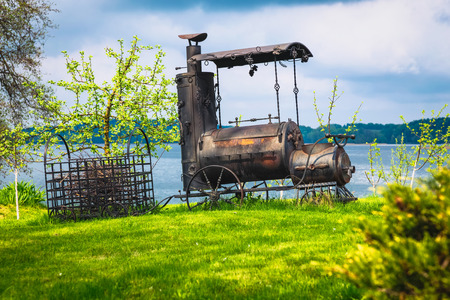 antiquities: Miniature model or concept of a steam smoking coal train which transporting tree