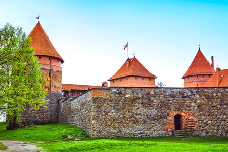 Red brick towers and stone wall of castle in Trakai, Lithuania