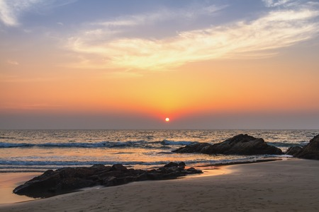 horison: Scenic view from sand beach in Goa to beautiful sunset above the Arabian sea