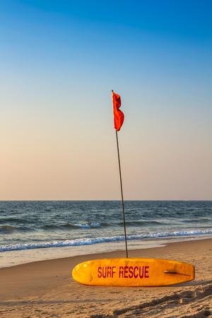 Rescue surfboard on the sand beach near the sea or ocean photo