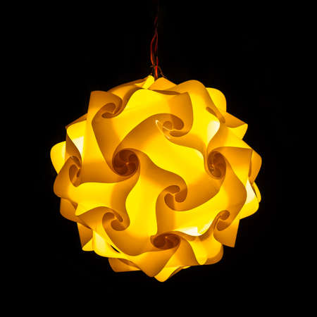 Yellow street lamp on black background Stock Photo