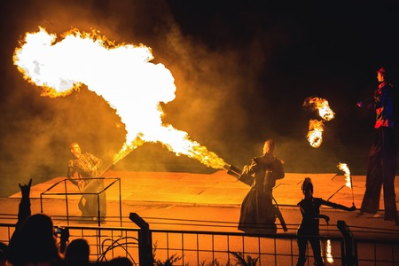 Minsk, Belarus - MAY 25, 2013  annual festival fire show  MIFF   Performance of artists on stage  Mans with flamethrowers