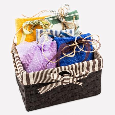 burlap sac: Decorative textile sachet pouches in gift box on white background Stock Photo