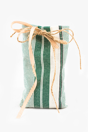 burlap sac: Decorative textile sachet pouch with a ribbon and bow on white background Stock Photo