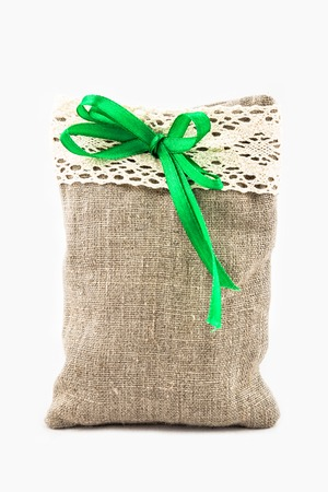 Decorative textile sachet pouch with a ribbon and bow on white background Stock Photo
