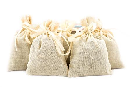 Textile sachet pouches on white background Stock Photo