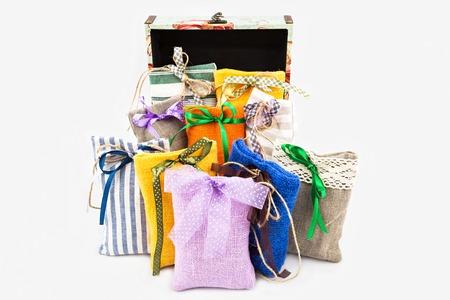 Decorative textile sachet pouches with gift box on white background Stock Photo