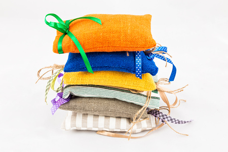 Decorative textile sachet pouches on white background