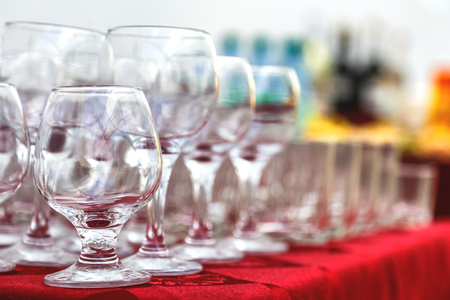 a meeting with a view to marriage: Empty wine glasses composition on table before celebration at outdoor