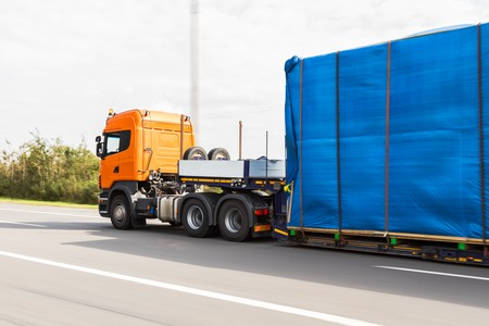 Truck delivery oversized cargo on the road