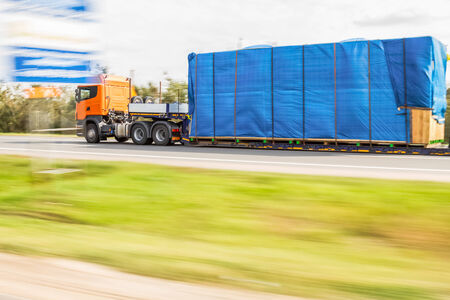 oversized: Truck delivery oversized cargo on the road