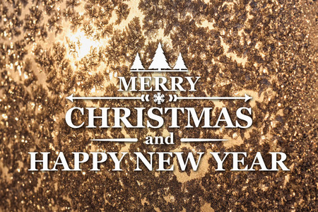 platinum: Merry Christmas and New Year greeting card on blurred frozen winter platinum or brown colored background