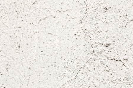fissure: Grunge plaster cement or concrete wall texture white and gray color with crack Stock Photo