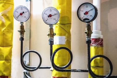 Manometers and pipes on pharmaceutical industry or chemical plant