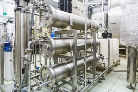 Pipes in conditioning or destilation room on pharmaceutical industry or chemical plant