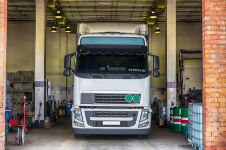 shop interior: Truck or lorry in repair shop service garage interior