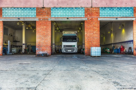 Truck or lorry in repair shop service garage Stock Photo