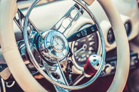 Steering wheel in interior of retro old or vintage automobile or car. Processed by vintage or retro effect filter Archivio Fotografico