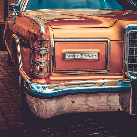 side effect: Old retro or vintage car or automobile front side with front light or headlight. Processed by vintage or retro effect filter