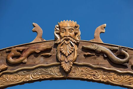 neptun: Neptun or Poseidon face and head wooden signboard on blue background