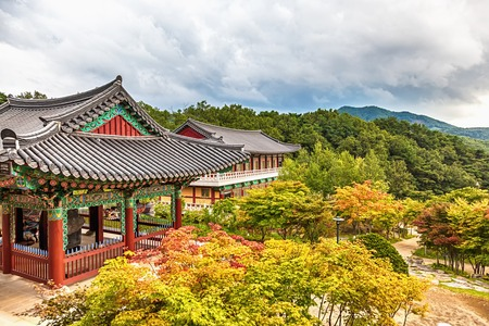 Traditional asian buddhist monks temple in mountains in South Korea at autumn