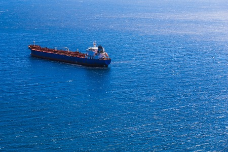 Empty container cargo ship in the open ocean or sea Stock Photo
