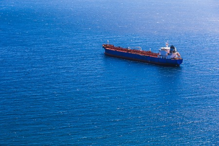 Aerial view to empty container cargo ship in sea