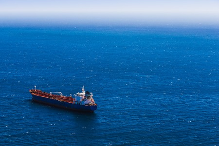 View from above to container cargo ship in the blue ocean Archivio Fotografico
