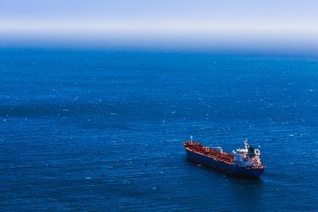 Aerial view to empty container cargo ship in the blue ocean Archivio Fotografico