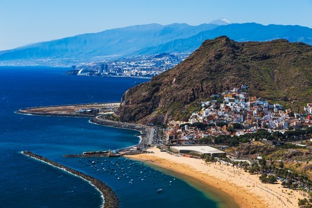 santa cruz: Coast or shore of Atlantic ocean and beach Las Teresitas in Santa Cruz city on Tenerife Canary island, Spain at spring or summer. Teide volcano at background