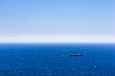 tanker ship: Cargo ships with containers in the open Atlantic ocean